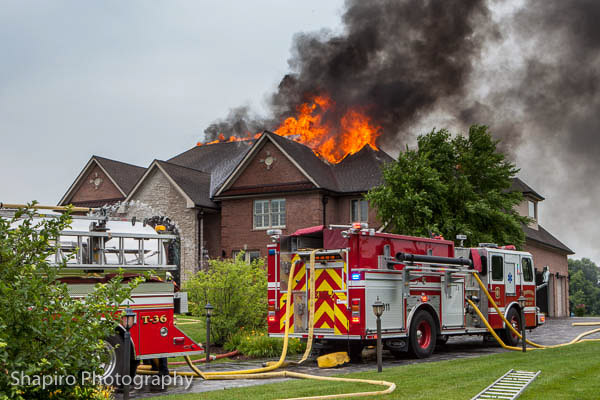 massive house gutted by fire after lightning strike in South Barrington IL 7-9-13 Larry Shapiro photography
