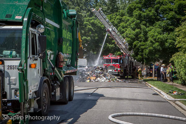 Buffalo Grove FD douses a garbage fire from the contents of a garbage truck on Logsdon Lane 7-8-14 Larry Shapiro photographer shapirophotography.net