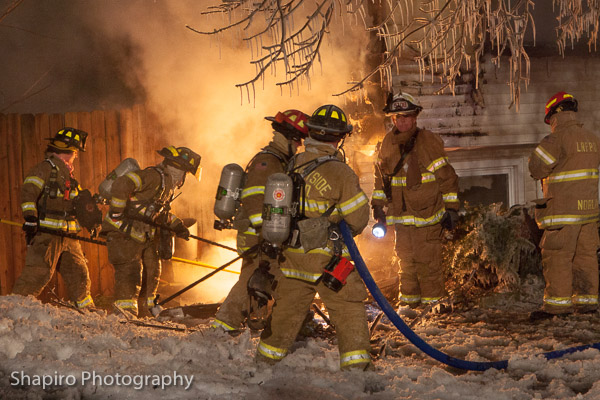 photos of Lincolnshire Riverwoods firemen battling a winter house fire at night at 20538 Clarice in Prairieview 1-20-14 lary shapiro photography