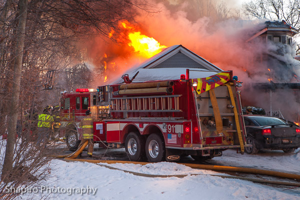 photos of Newport Township FPD firemen battling a house fire in Wadsworth IL 1-23-14 larry Shapiro photography