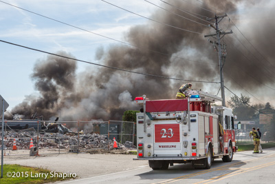 Wheeling IL firefighters fight a large debris fire at a demolition site at 1760 W Hintz Road 9-25-15 shapirophotography.net Larry Shapiro photographer