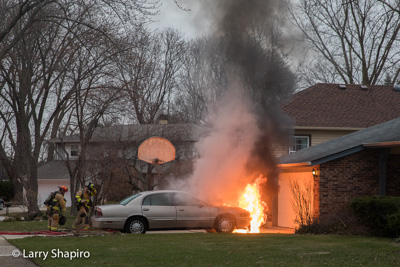 Buffalo Grove Firefighters extinguish a car fire at 999 Harvard Court 3-27-17 Larry Shapiro photographer Shapirophotography.net