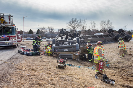 Firemen rescue two trapped occupants of a tractor trailer that rolled over in Long Grove IL 3-18-15 Larry Shapiro photographer shapirophotography.net
