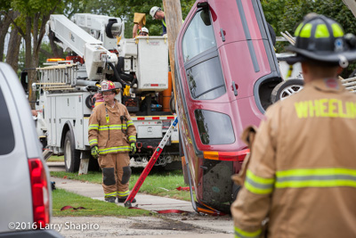 Wheeling Fire Department SUV crash in Wheeling 9-23-16 shapirophotography.net Larry Shapiro photographer car stuck on utility pole support cable