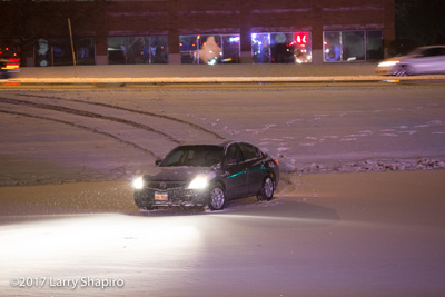 Wheeling Fire Department IL car on the frozen pond in a snowstorm Lake Cook Road and Northgate Drive shapirophotography.net Larry Shapiro photographer #larryshapiro 12-28-17