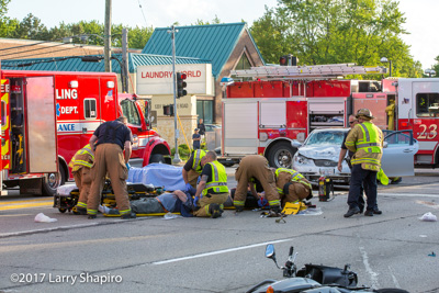 Wheeling IL fire department police department MVA with injuries motorcycle and car Rosenbauer Commander fire engine ambulance Freightliner Dundee Road and Schoenbeck Road #larryshapiro shapirophotography.net Larry Shapiro photographer 5-30-17
