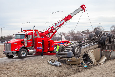 Hillside Towing Company uprighting an overturned tractor-trailer and recovering steel coils 3-18-15 near Long Grove IL Larry Shapiro photographer shapirophotography.net